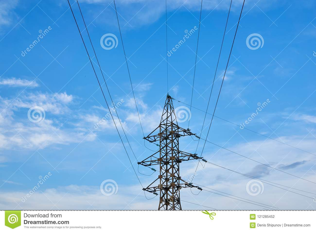 A line of high-voltage cables against a blue sky with clouds.