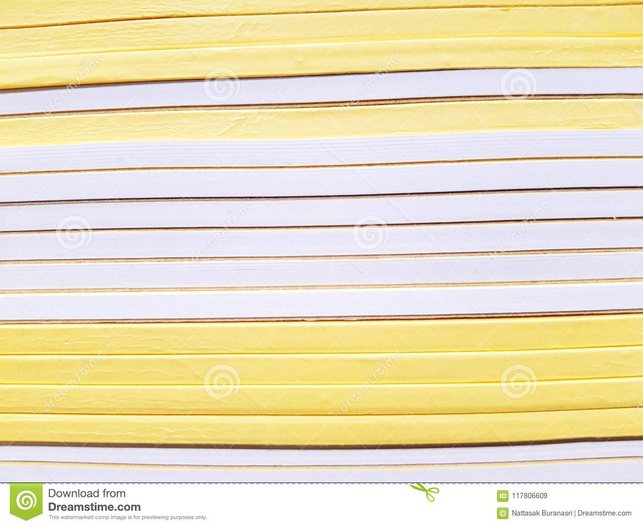 Line Pattern Of Saddle Yellow And White Books Stack On The Bookshelf At Stationery