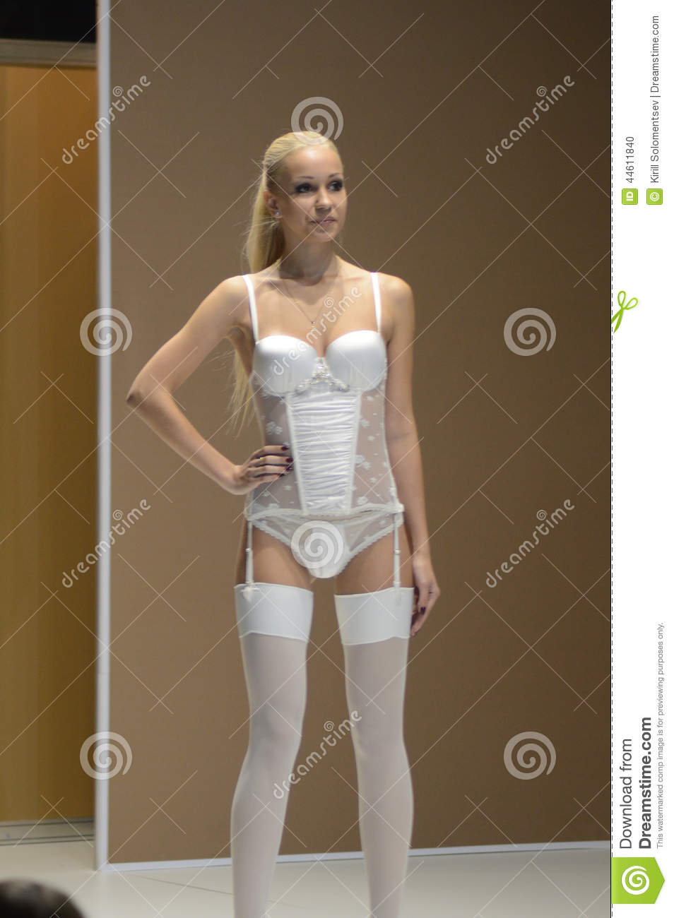 7b666d88f Lingrie Expo Fashion Show Young Woman In White Stockings And ...