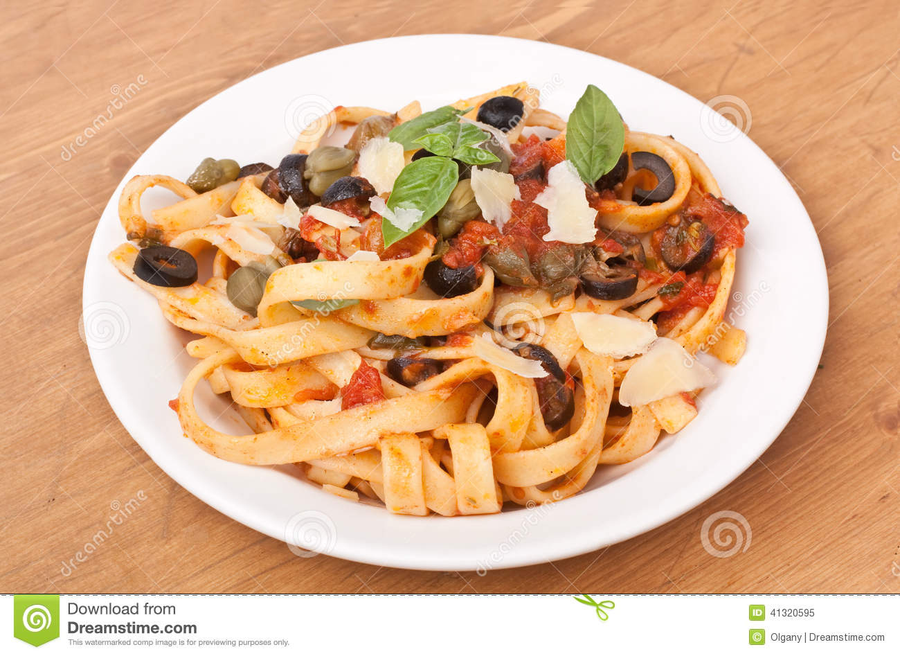 Pasta with Fresh Tomato Puttanesca Sauce, Grated Parmesan Cheese ...