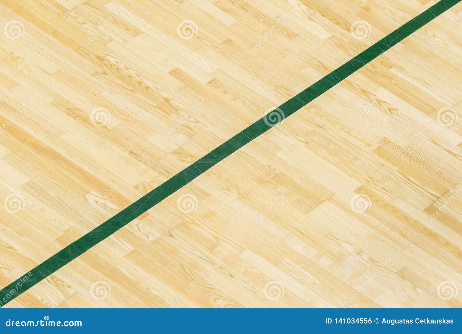 A linha verde no assoalho do ginásio para atribui a corte dos esportes Badminton, Futsal, voleibol e campo de básquete
