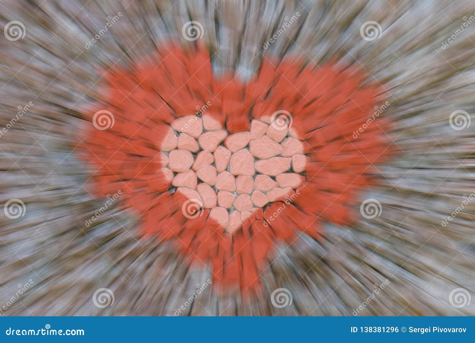 Linhas abstratas do borrão de movimento da aceleração do fundo que aproximam rapidamente o símbolo vermelho da imagem da pedra do