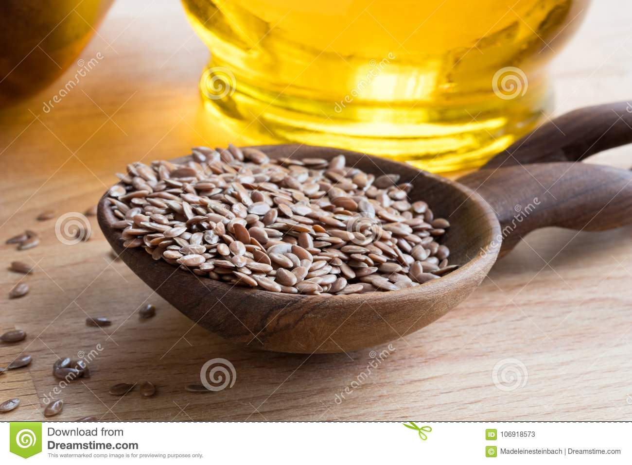 Linseed On A Wooden Spoon With Flaxseed Oil In The Background Stock