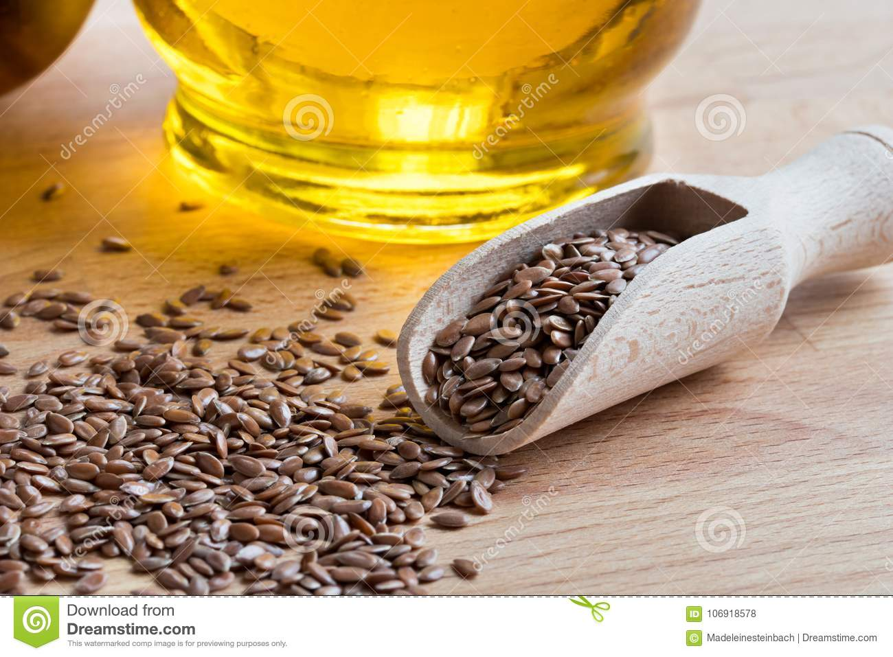 Linseed On A Wooden Table With Flaxseed Oil In The Background Stock