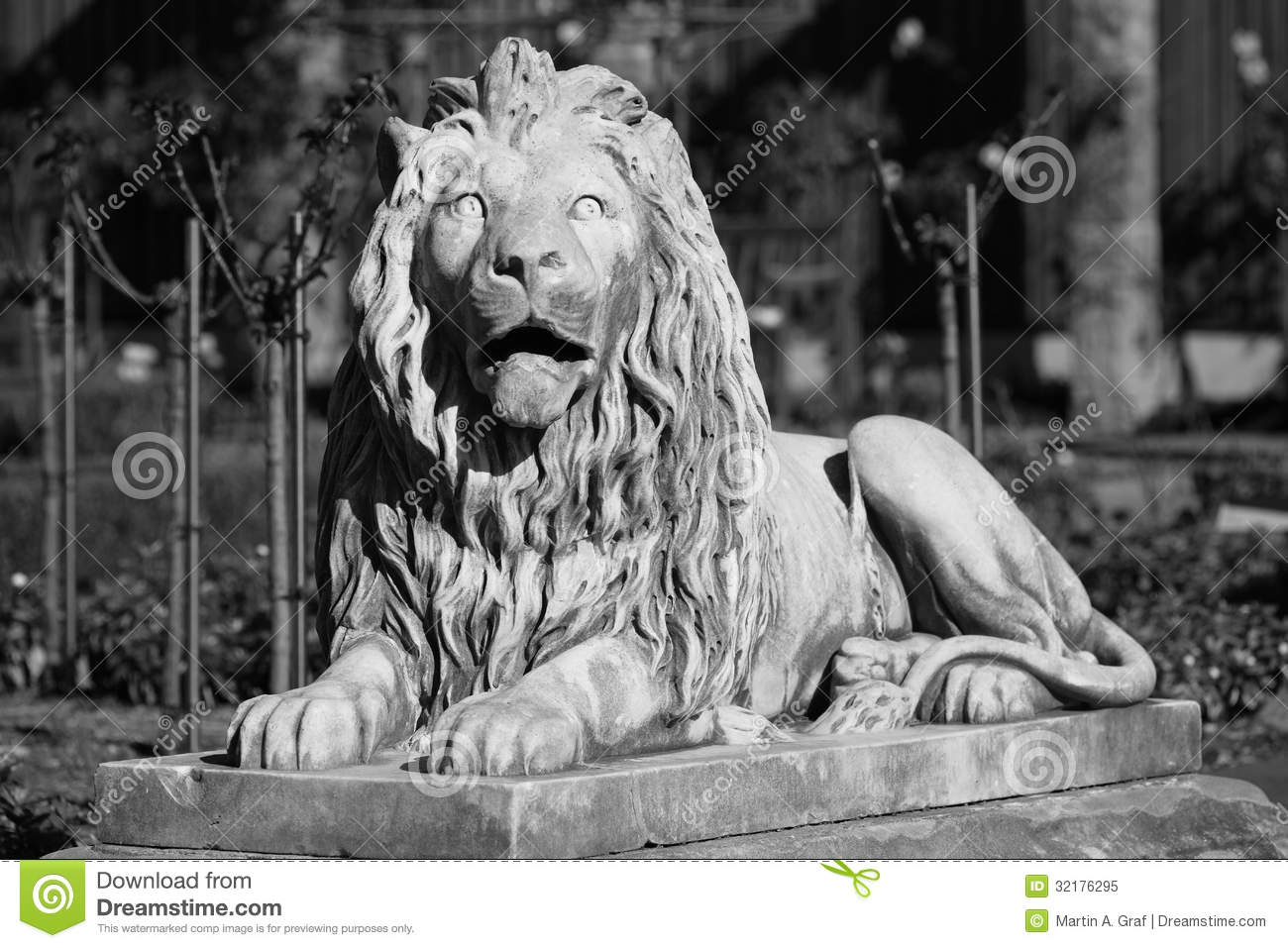 Black and white photography of a lion sculpture made of stone decorative in the royal botanic garden of sydney australia