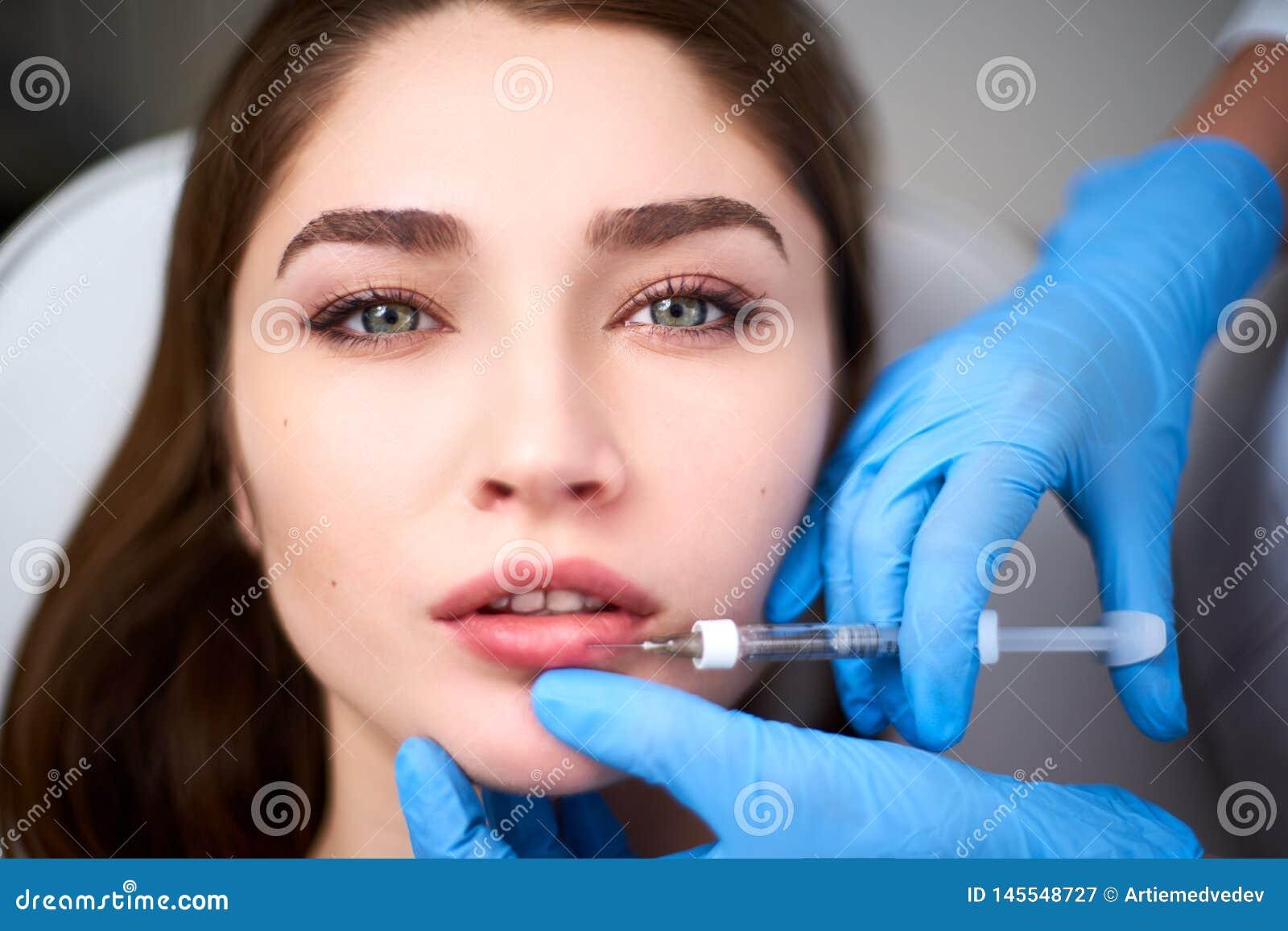 Lip Augmentation  Closeup Of Beautician Doctor Hands Doing Beauty
