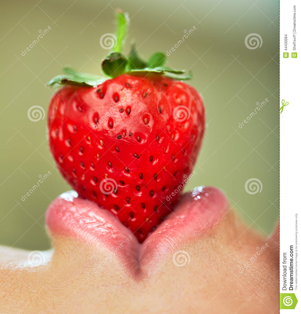 Lips with strawberry.