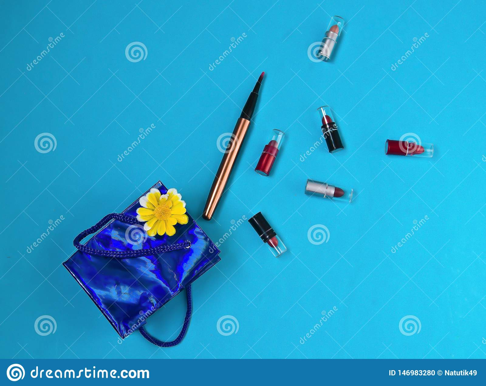 Lipstick, brush, package, gift, surprise,on blue background
