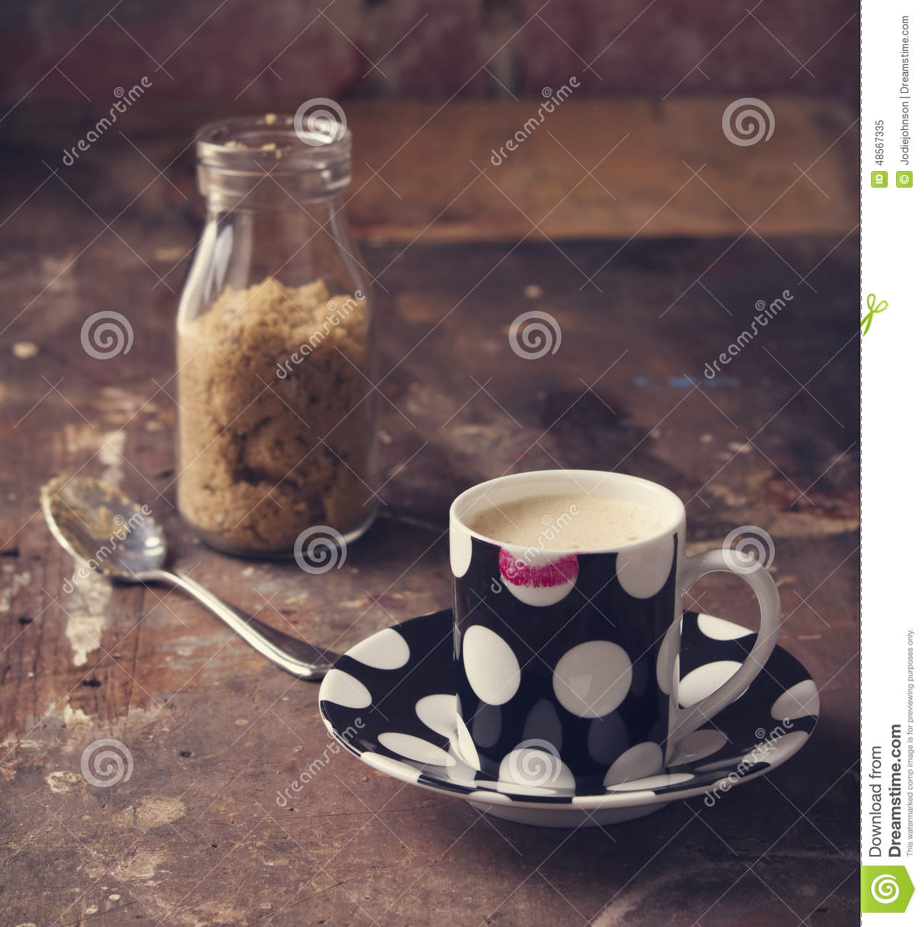 Lipstick on coffee cup in rustic cafe or studio setting