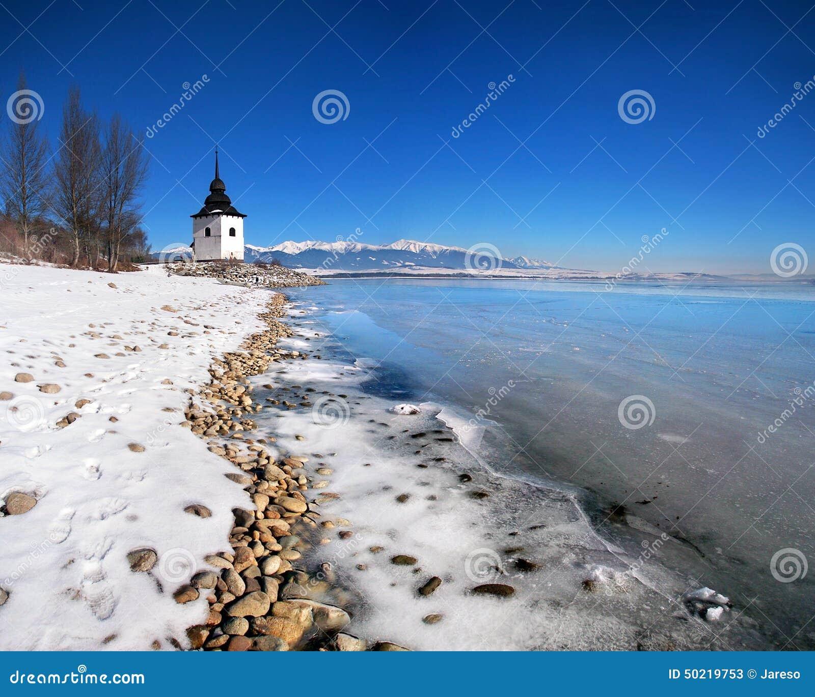 The Liptovska Mara lake frozen with ice