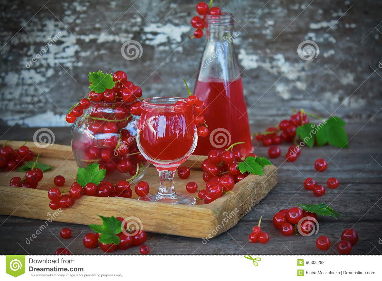Liqueur of red currant in the glass