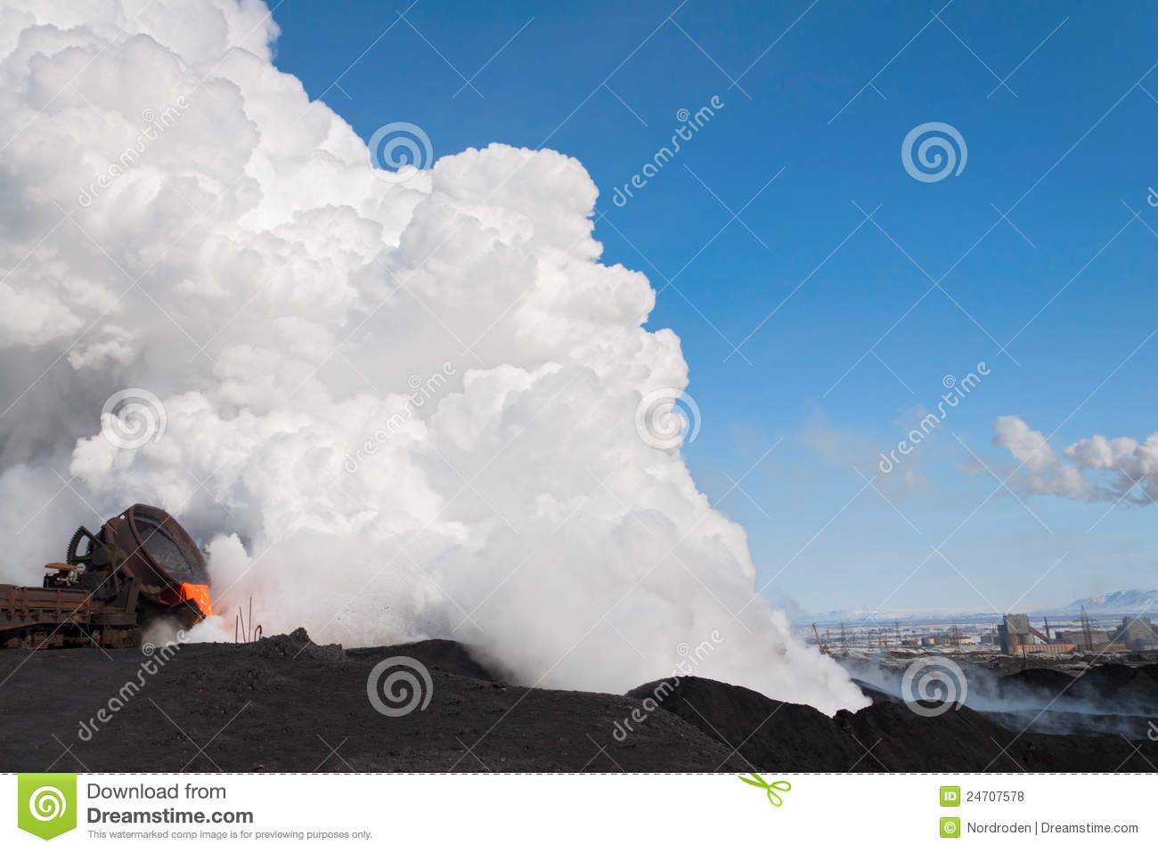 The liquid molten slag and a cloud of hot steam generated during the ...