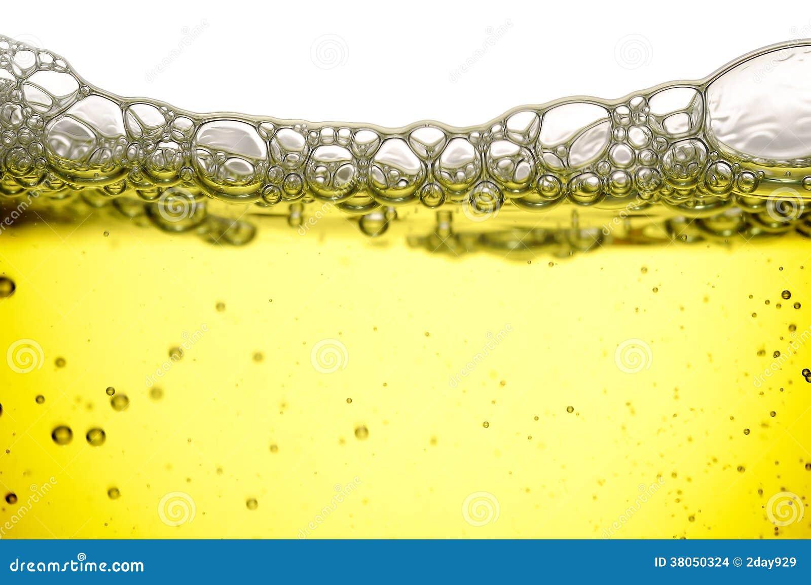 liquide jaune avec des bulles photo stock image du savon studio 38050324. Black Bedroom Furniture Sets. Home Design Ideas