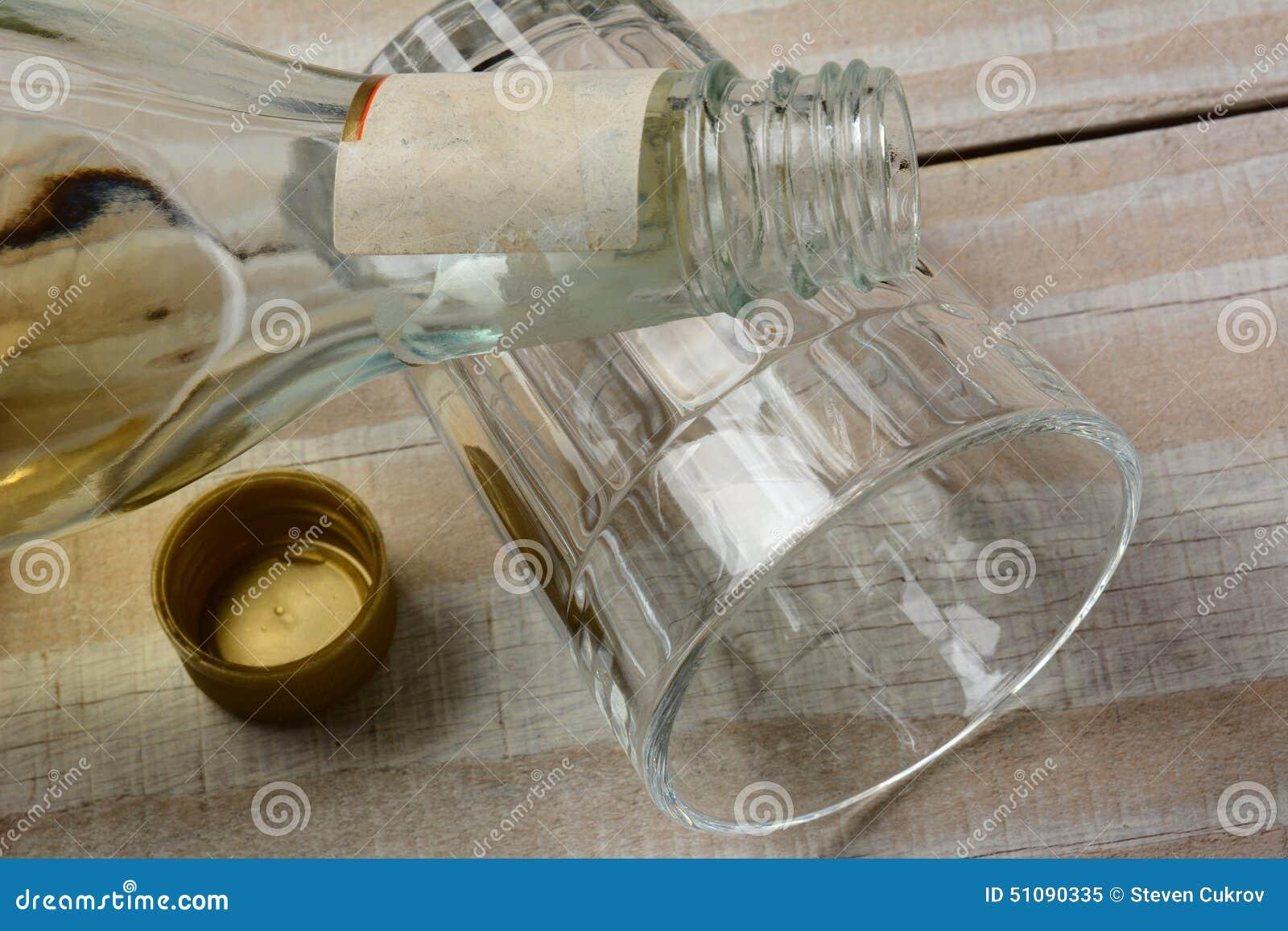 Liquor Bottle On Glass Stock Image. Image Of Liquor