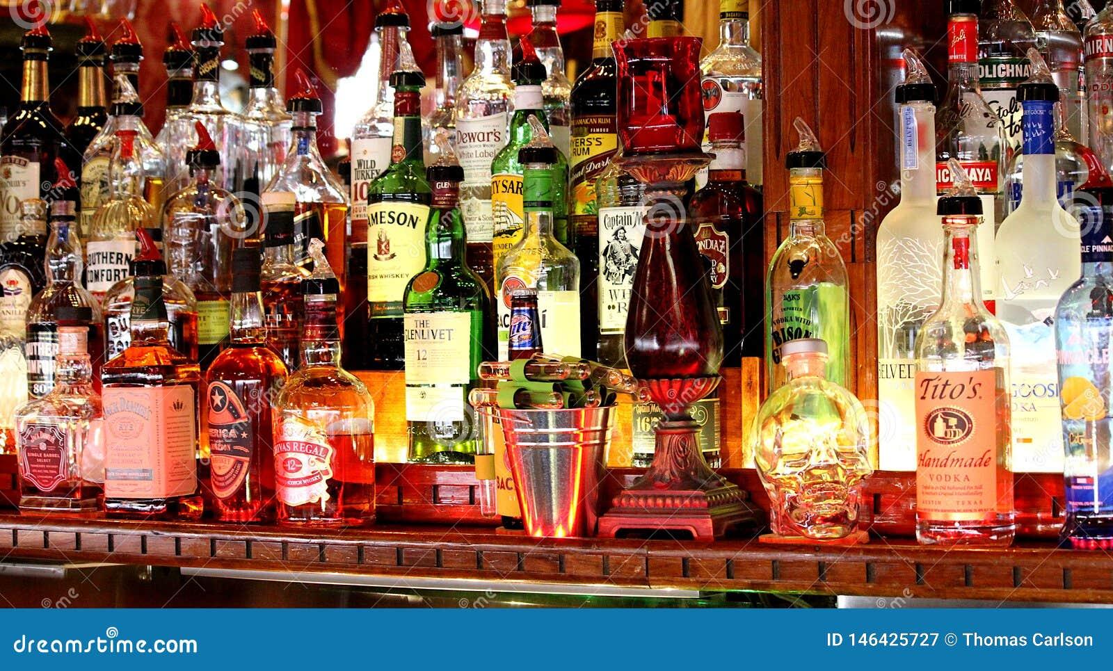 Liquor bottles behind a bar.
