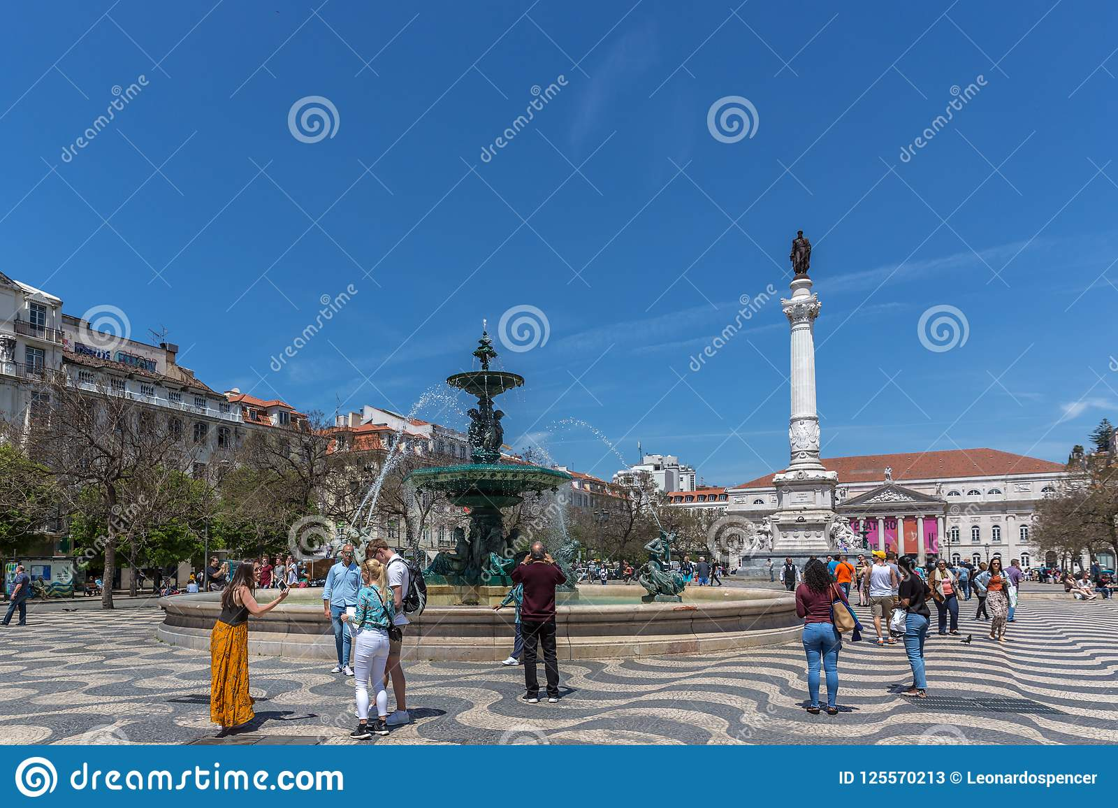 Lisbon, Portugal - May 9th 2018 - Tourists and Locals walking at the Rossio boulevard in downtown Lisbon, Portugal`s capital at a