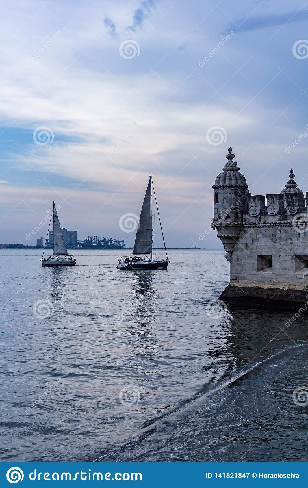 Lisbon Portugal. May 7, 2018. View of a portion of the famous tower of Bethlehem. Next to it, small sailboats sail on the river