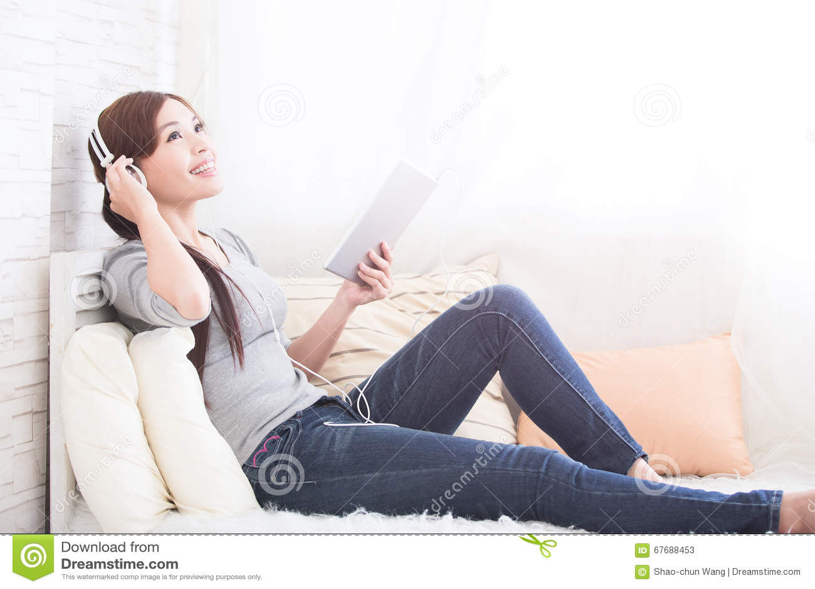 Download Listen Music In Digital Tablet Stock Image - Image of adult, living: 67688453
