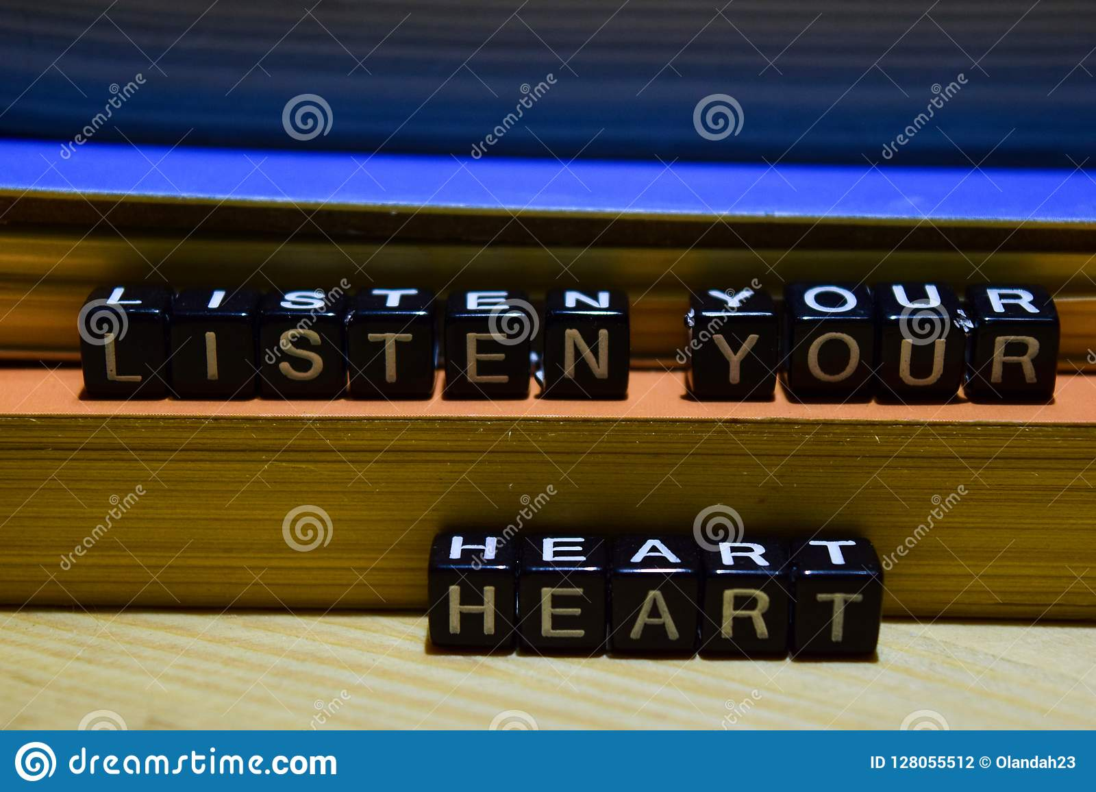 Listen your heart written on wooden blocks. Education and business concept