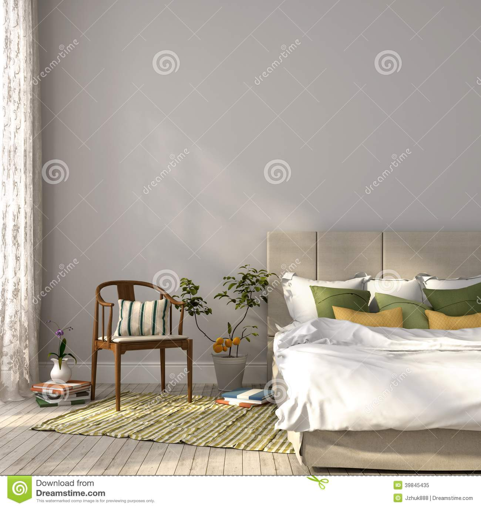Lit beige avec le décor vert