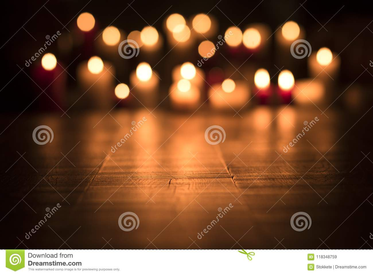 Lit candles burning in the Church