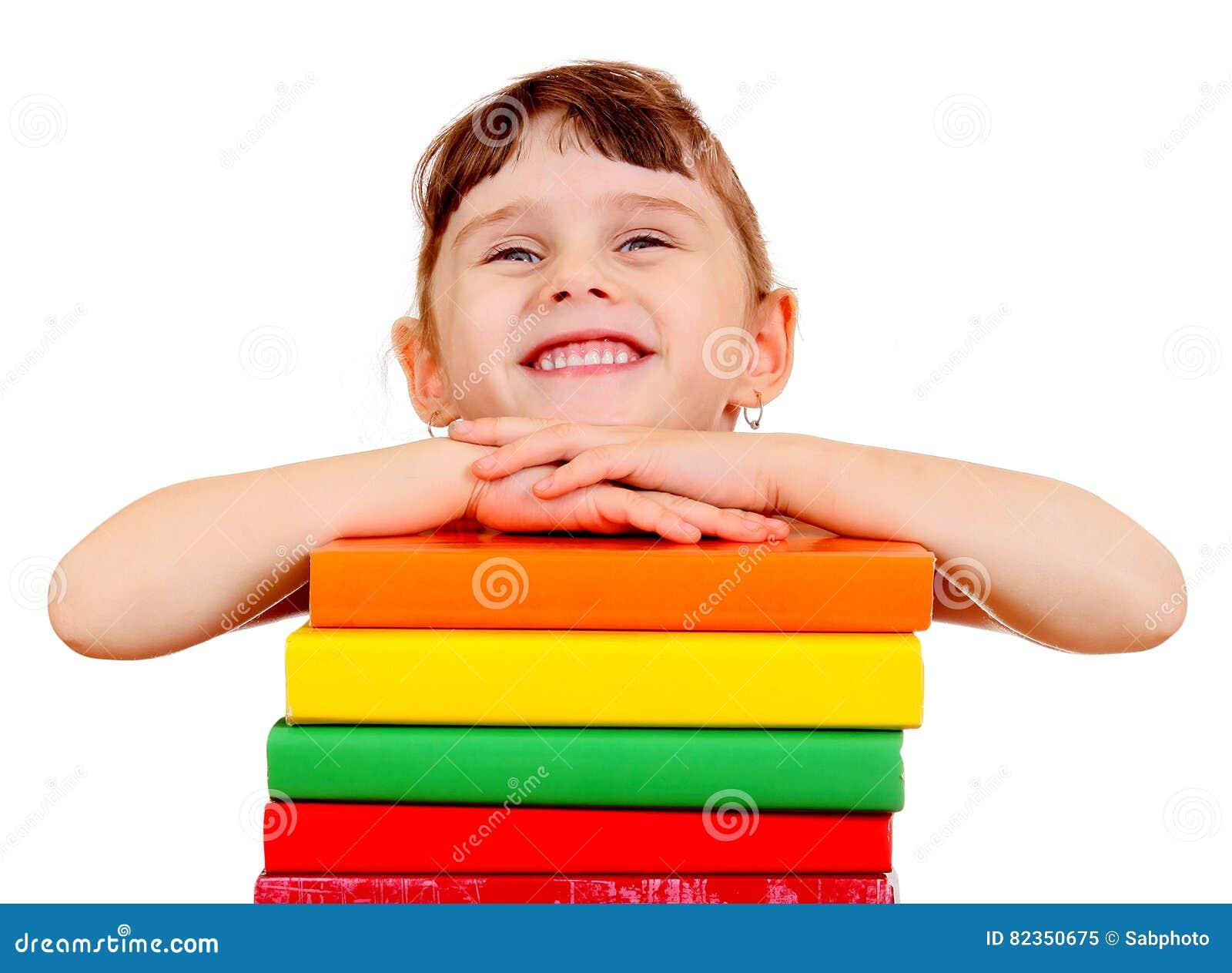Liten flicka med böcker