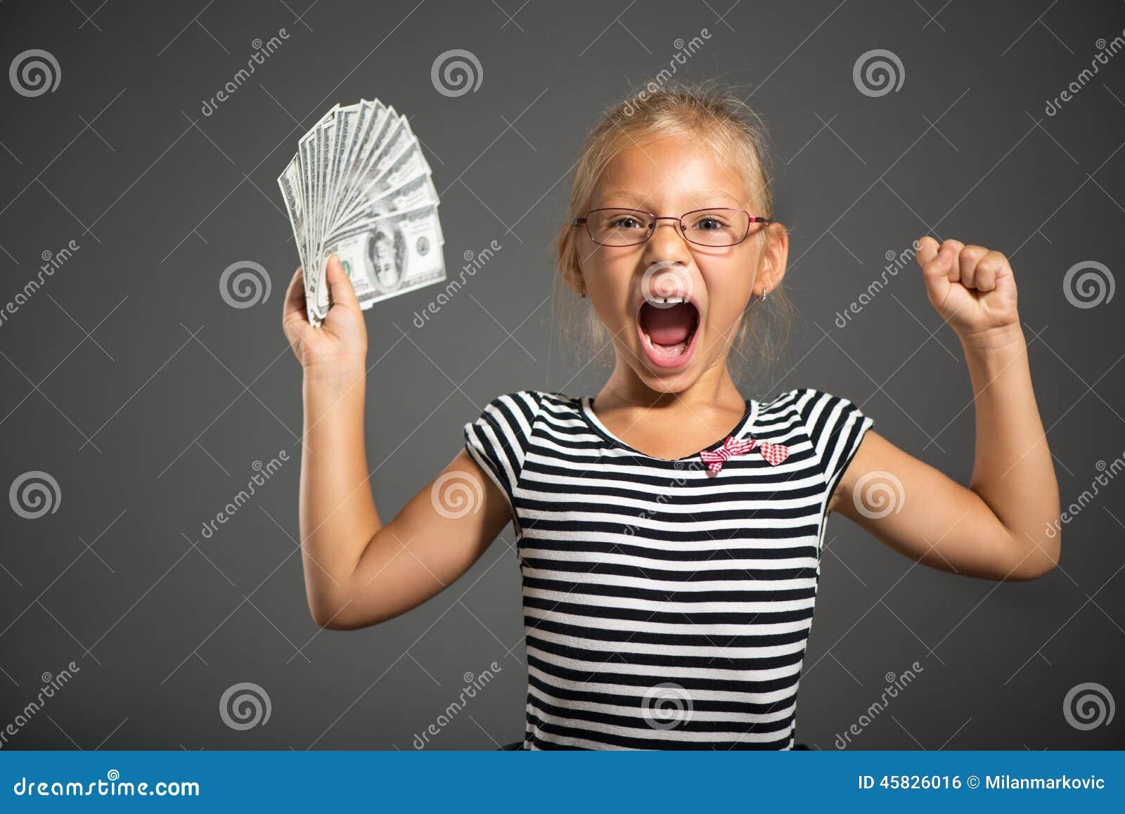 Liten flicka med pengar
