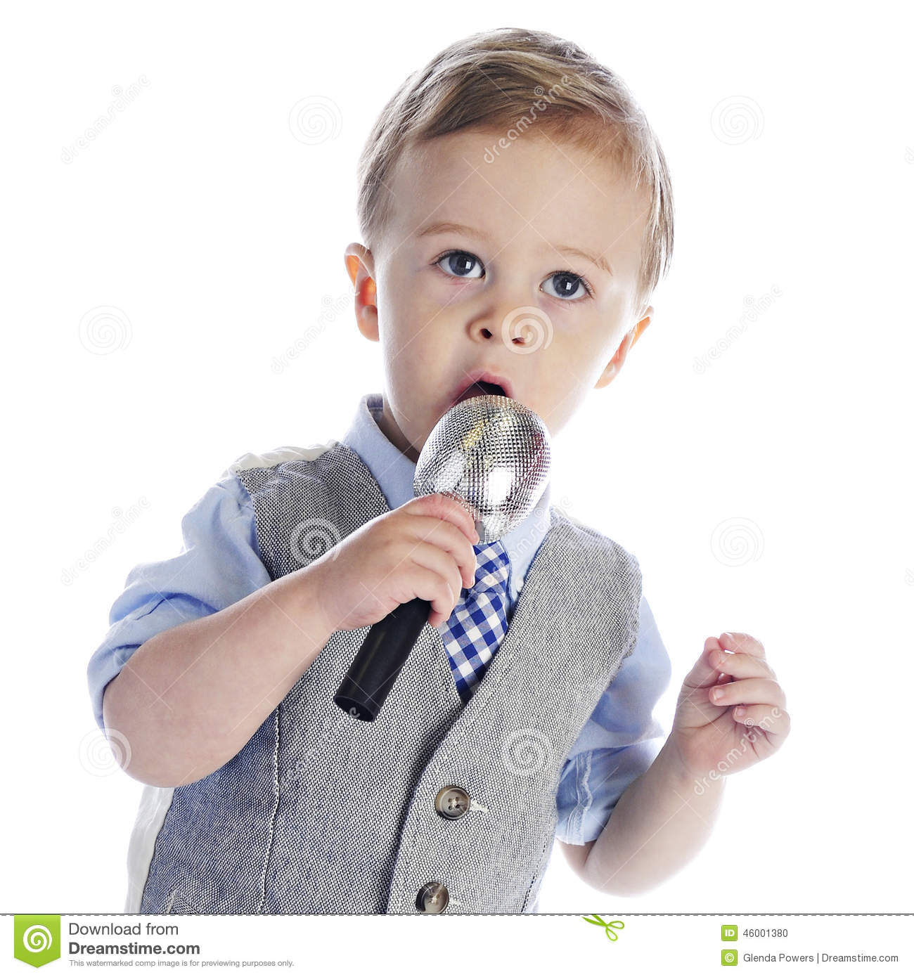 An adorable 2-year old singing (or talking) into a microphone. On a ...