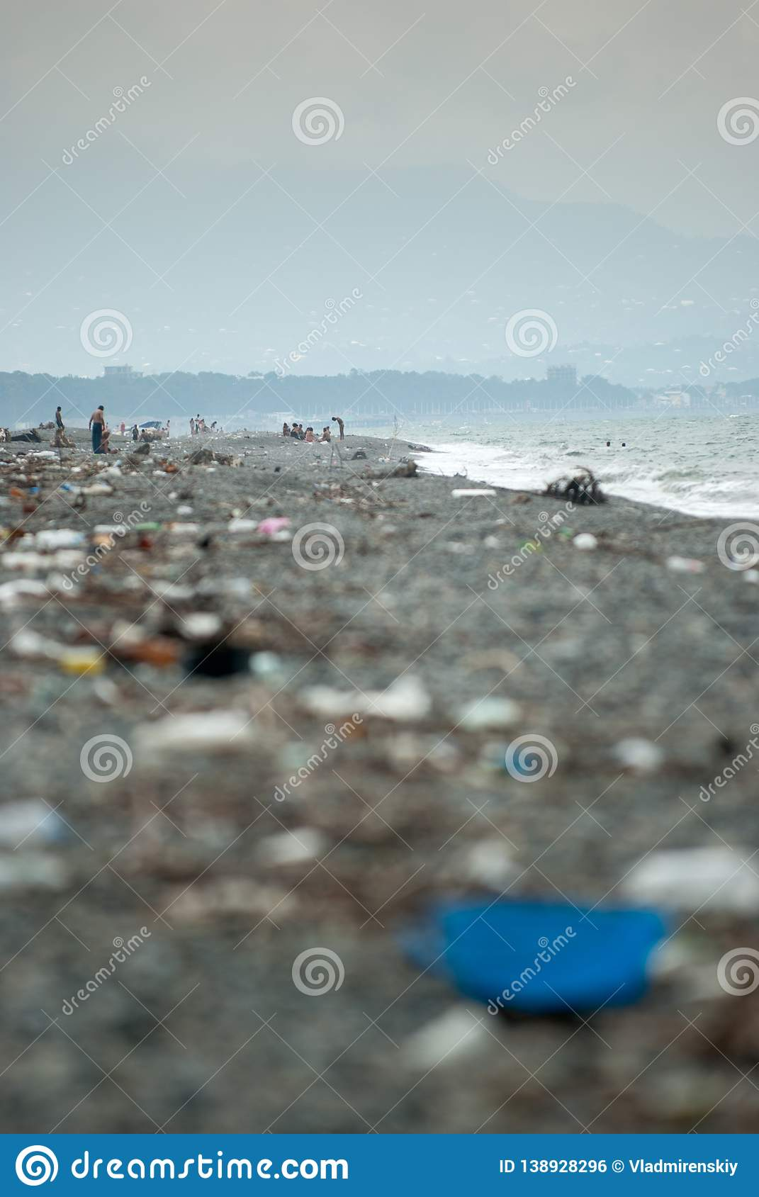 Pebbly beach in Poti Georgia covered with colored plastic trash