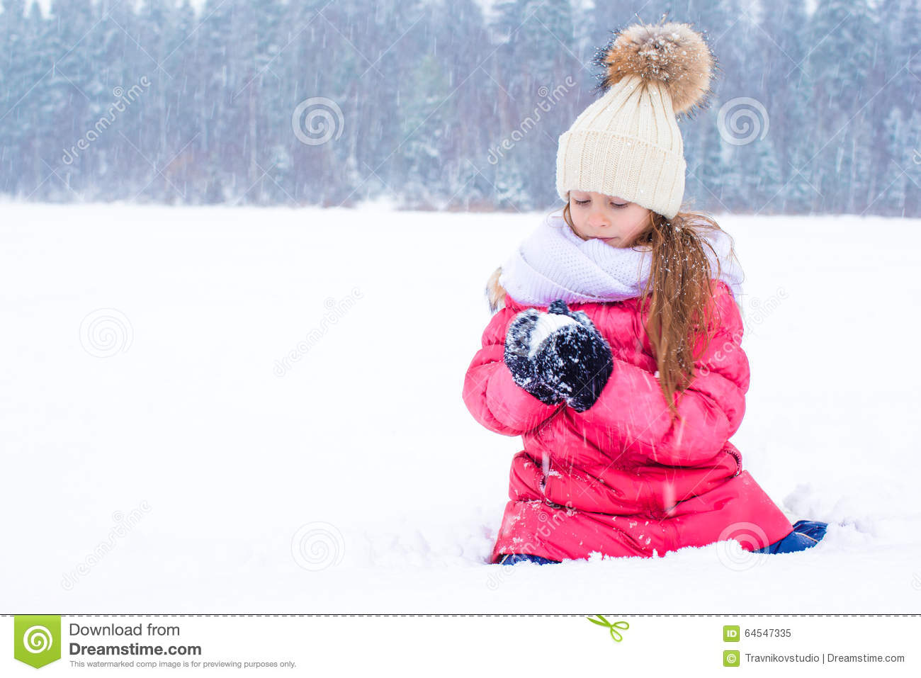 little adorable girl in snow sunny winter day stock photo