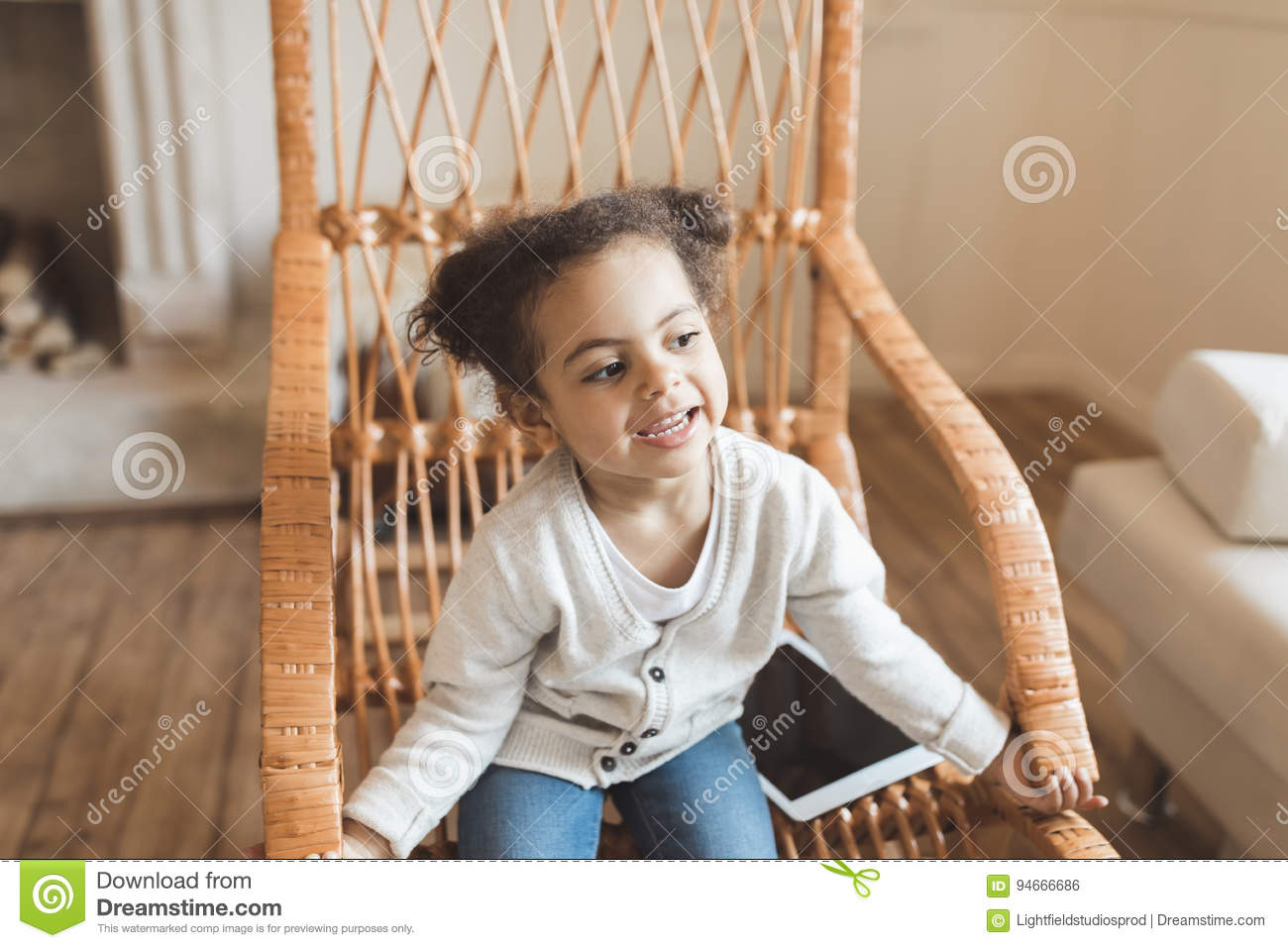 Little African American Girl With Digital Tablet And Sitting