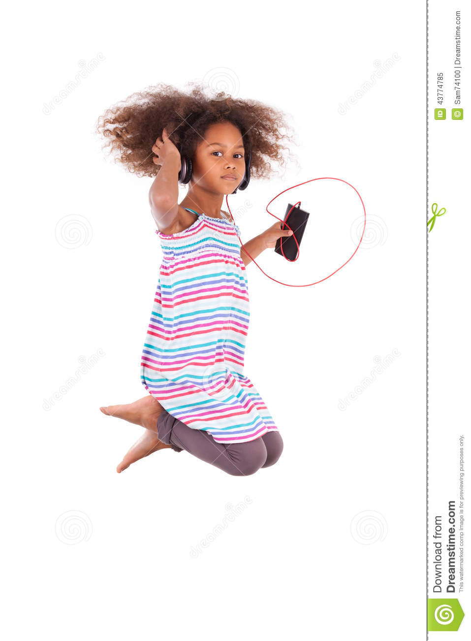 c42a7259 Little african american girl jumping and listening to music, isolated on  white background - Black people