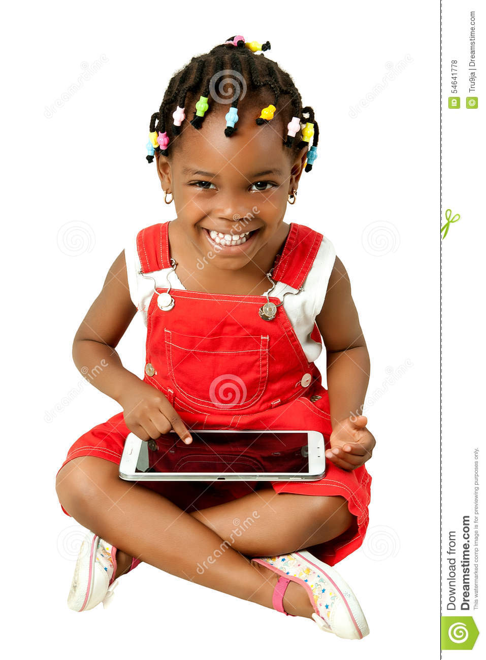 Little African American girl using tablet pc