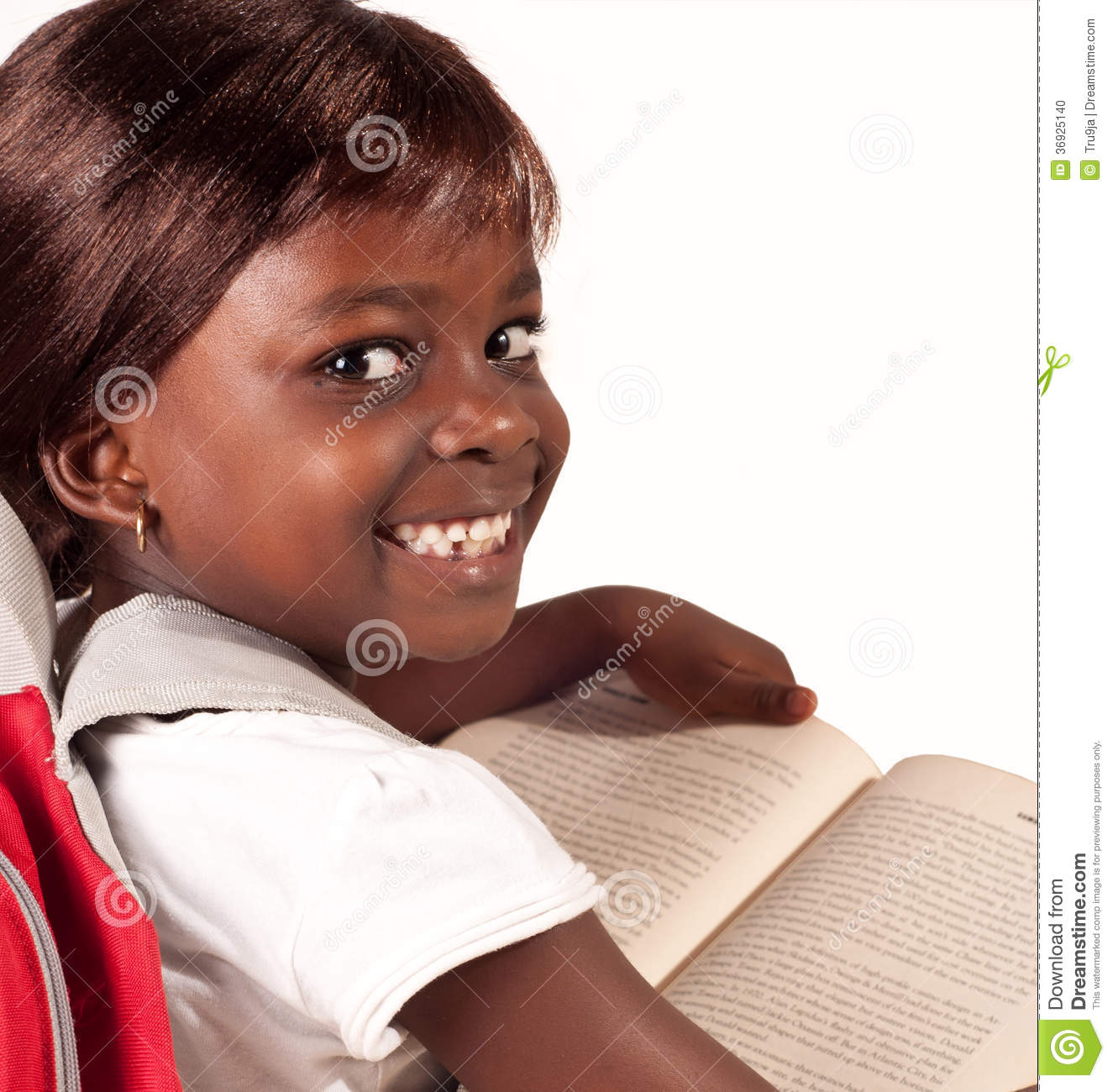 Clever School Girl: African School Girl Smiling At The Camera Stock Photo