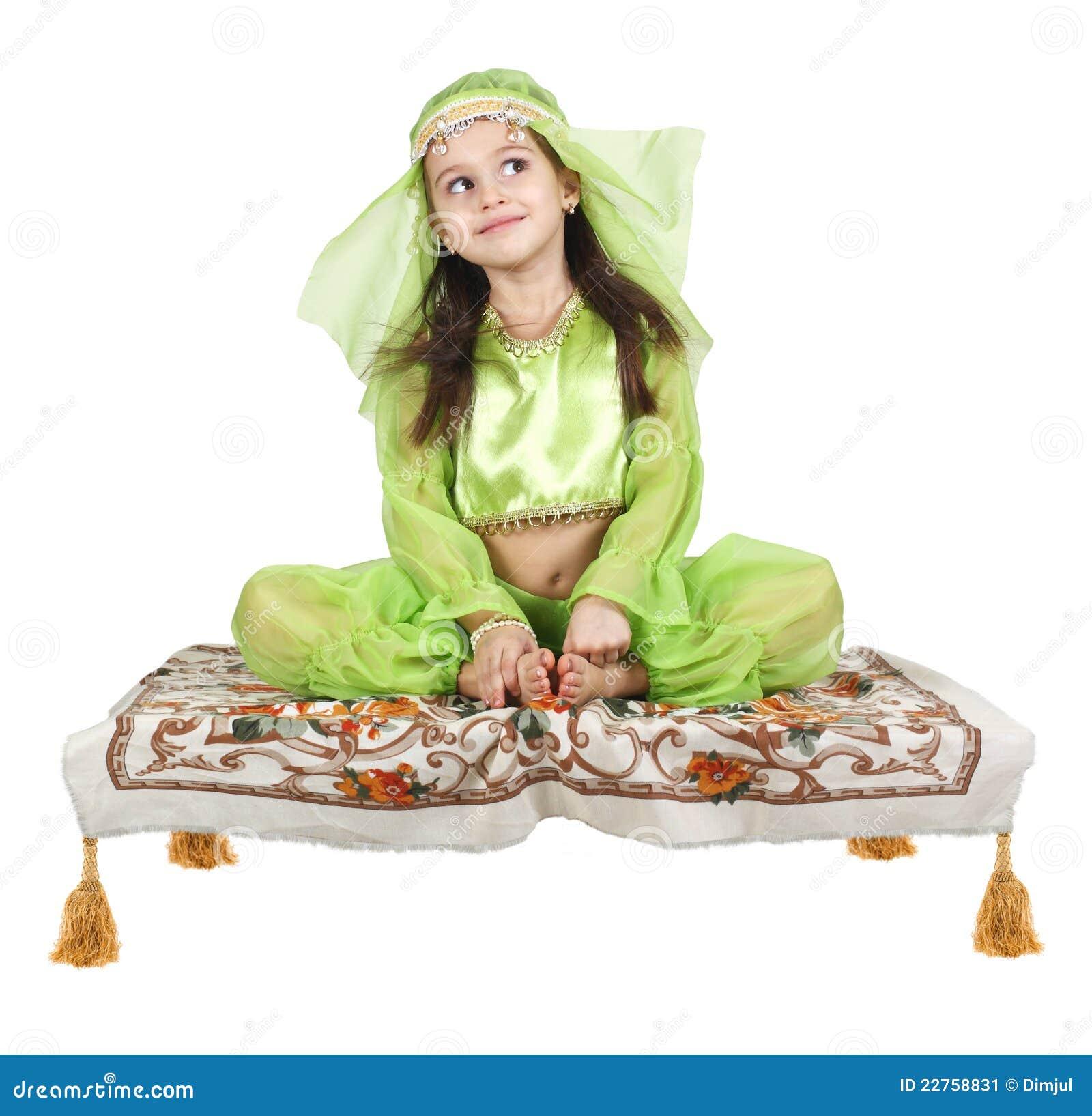 Little Arabian Girl Sitting On A Flying Carpet Stock Image