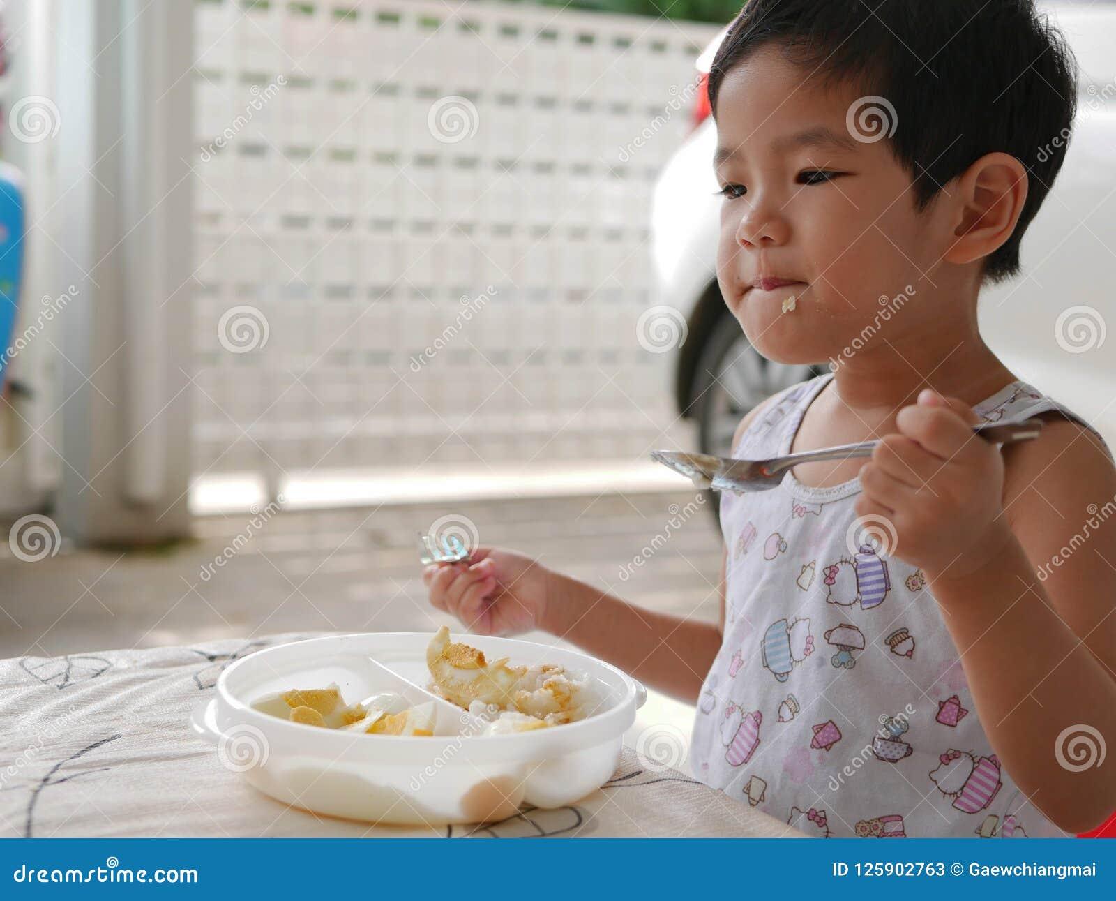 Asian girl eats herself