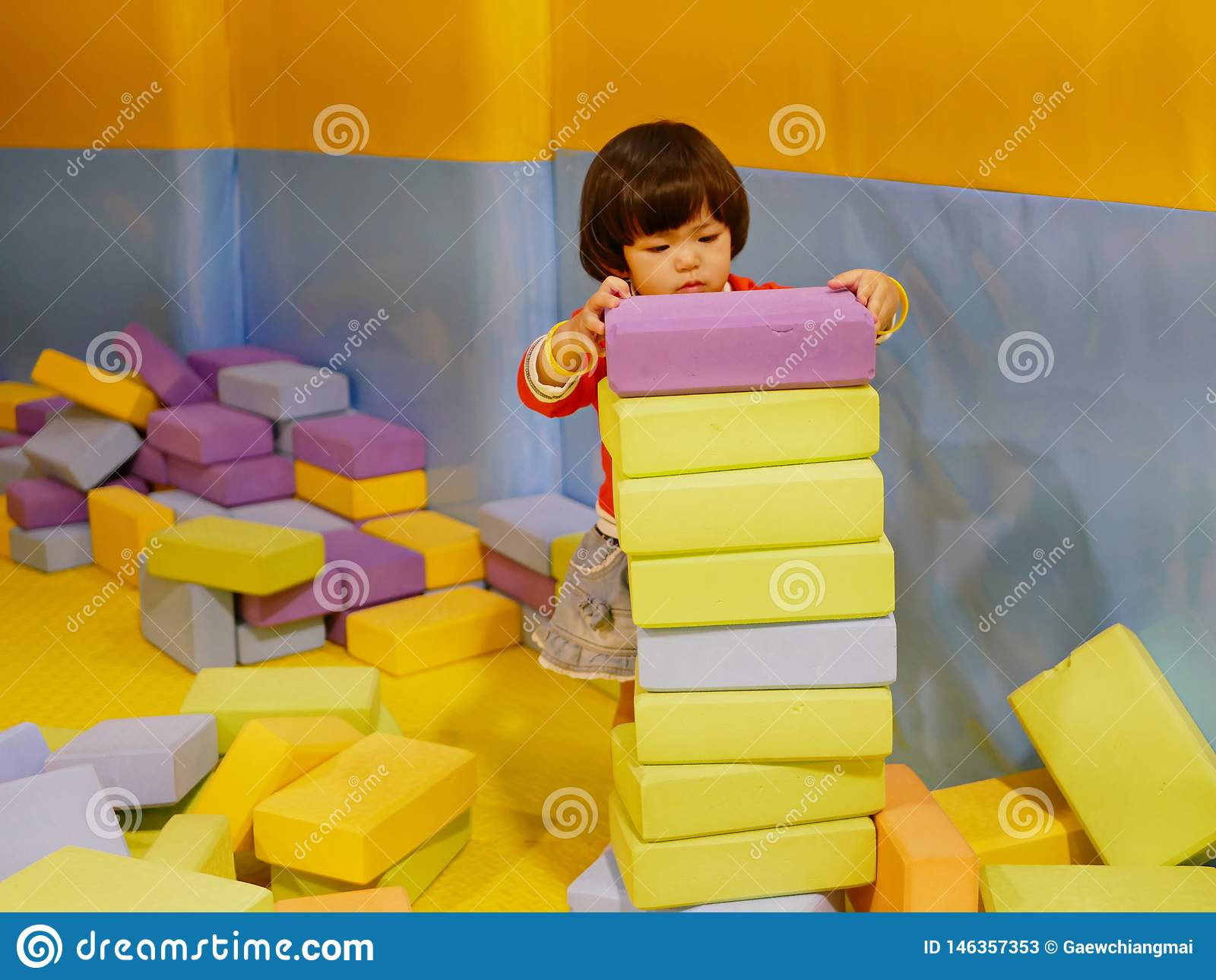 Little Asian Baby Girl Stacking Up Foam Building Bricks Blocks At An Indoor Playground Stock Image Image Of Bricks Develop 146357353