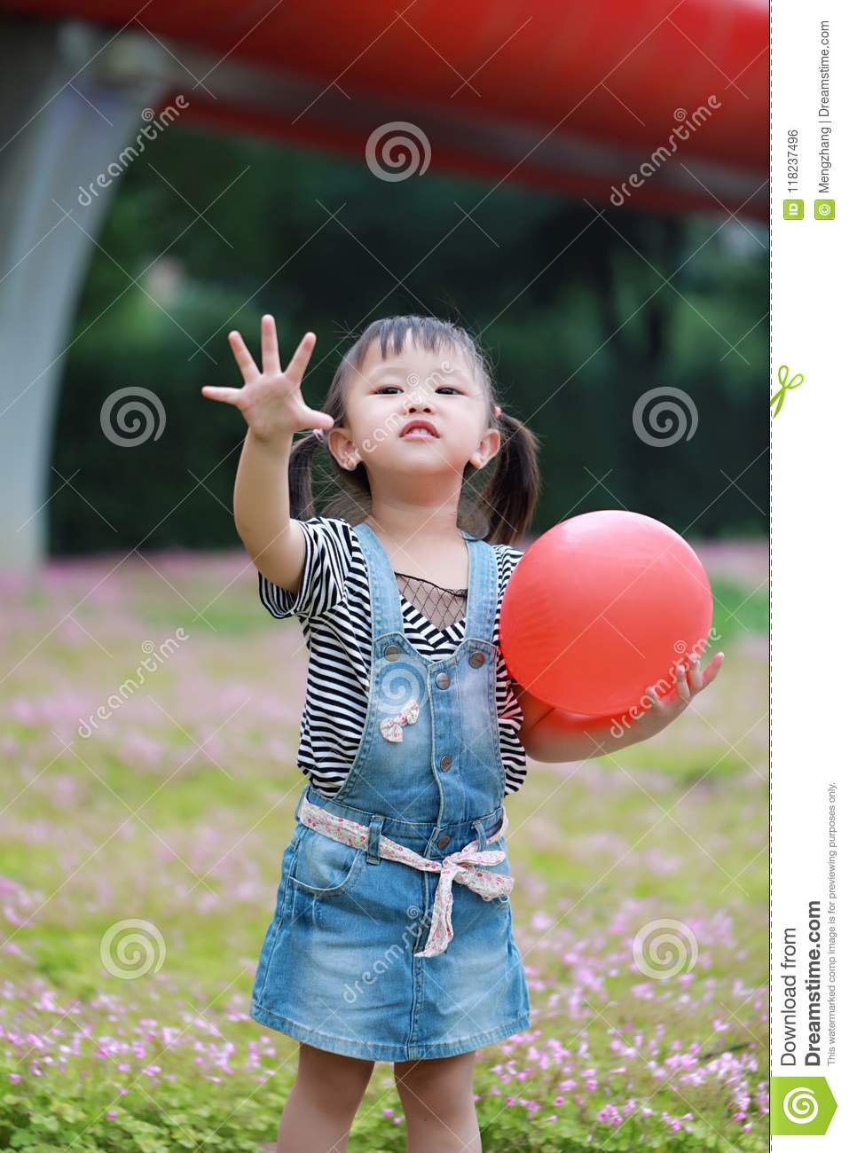 Aisa cute naughty lovely child girl with V pose play with balloon have fun outdoor in summer park happy smile happiness childhood