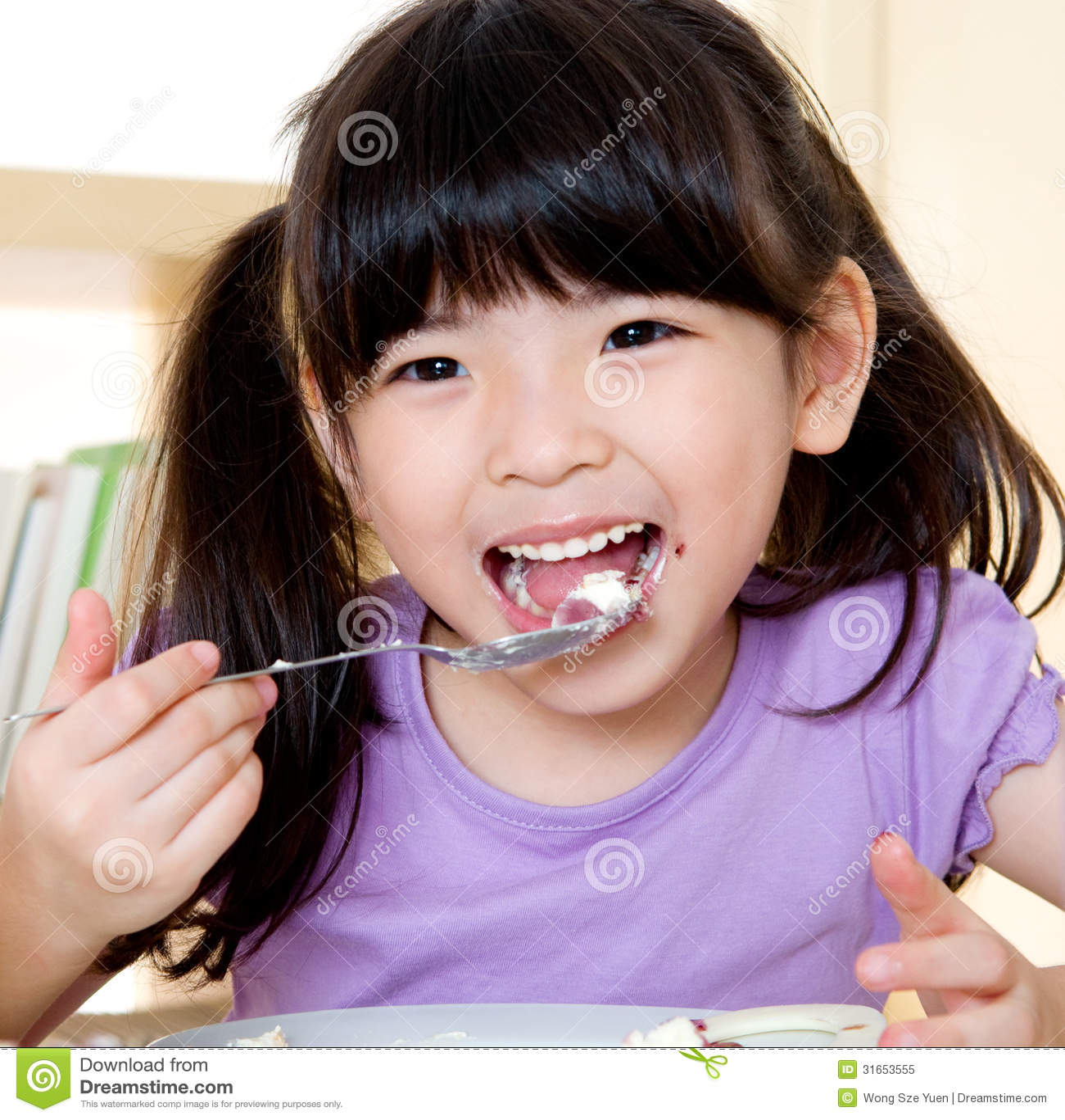 Little Asian Girl Eating Royalty Free Stock Photo Image