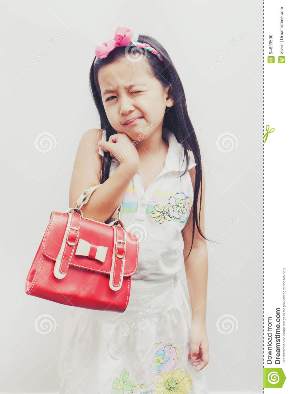 little asian girl holding a red handbags stock photo