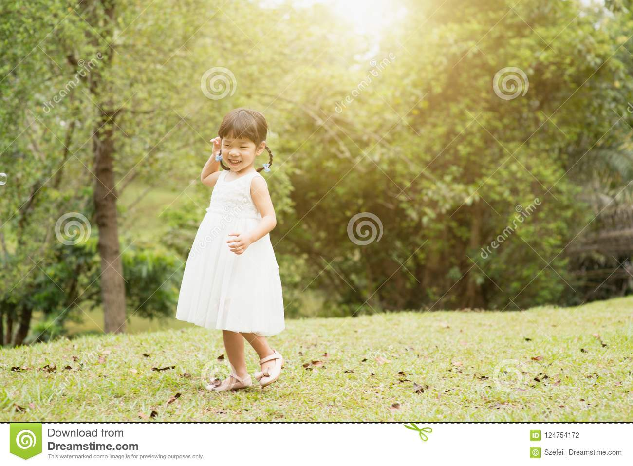 Little Asian girl playing at park