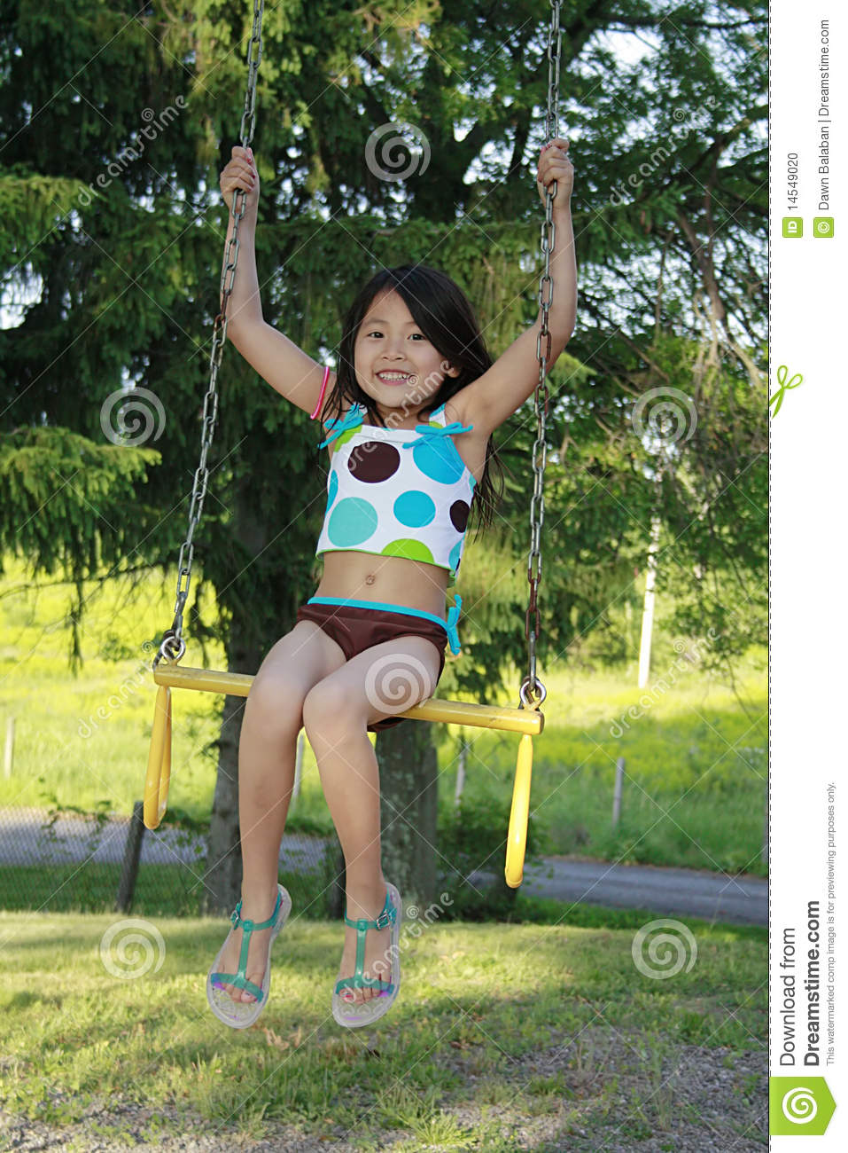 little asian girl swinging on a swing stock photo image swimsuit clipart bathing suit clipart black and white