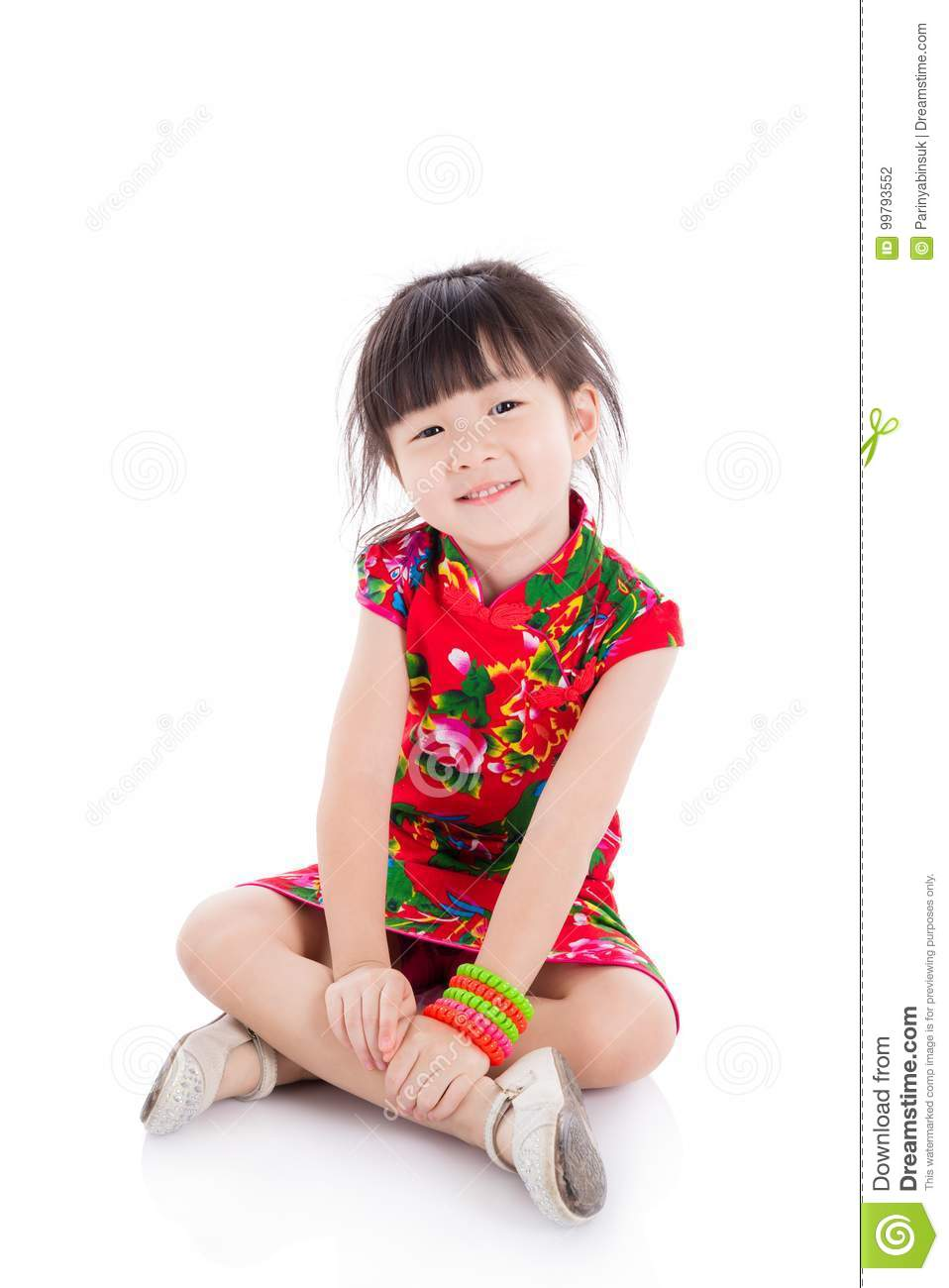456ecbafd51a Little asian girl wearing red chinese traditional dress sitting on the floor