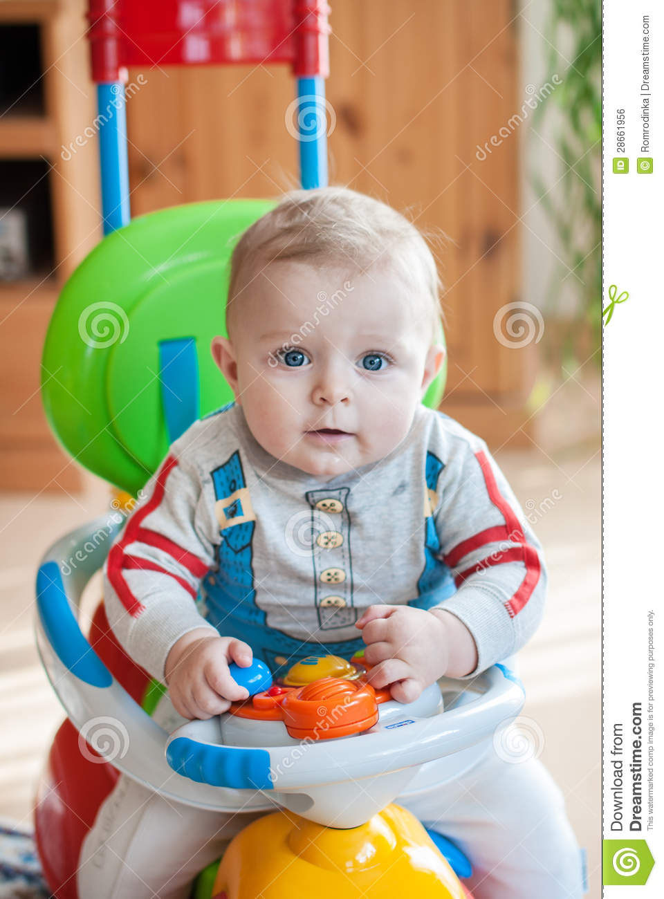 little baby boy in blue big toy car indoor royalty free stock image 28661956. Black Bedroom Furniture Sets. Home Design Ideas