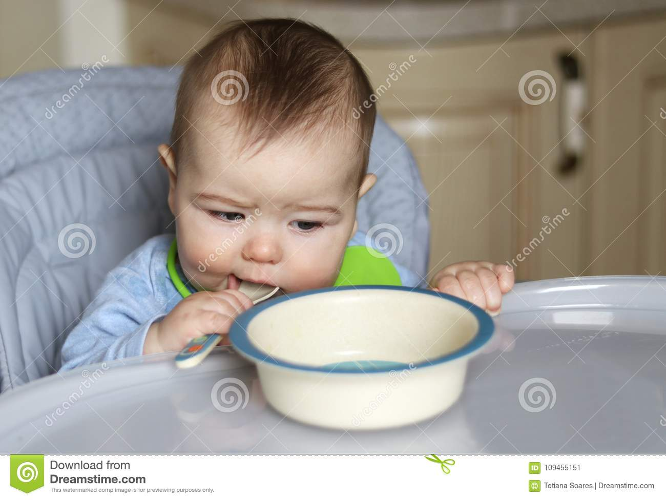 little baby boy eating in his feeding chair stock image image of