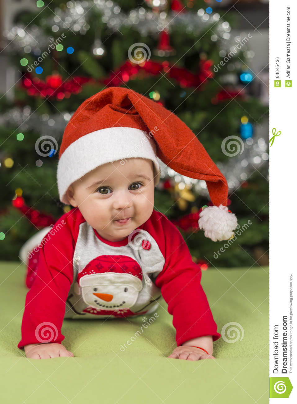 A smile from a little girl that stays in hands with Santa cap with Christmas  theme background 6d5393644