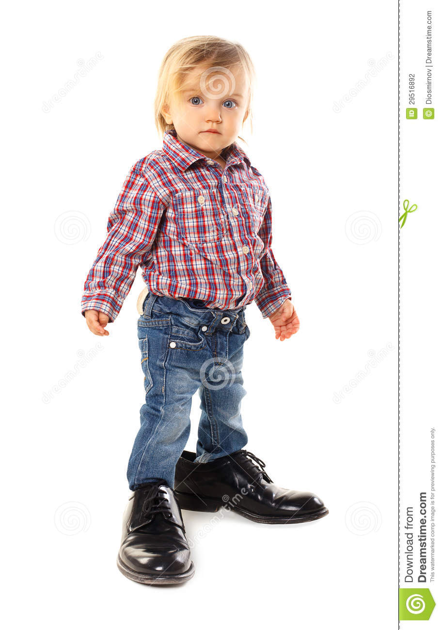 Little baby in father s shoes