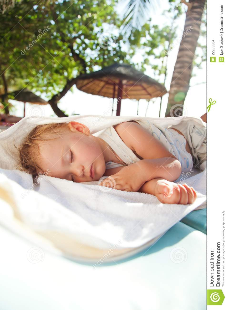 Little baby girl asleep on a chaise lounge stock images for Baby chaise lounge