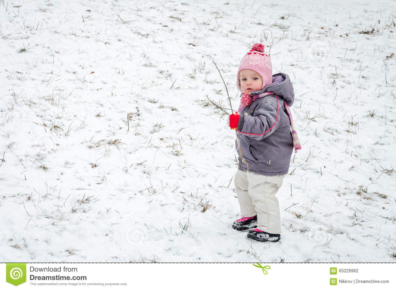 little baby girl beautiful winter day playing in the snow wearing a jacket hooded down jacket. Black Bedroom Furniture Sets. Home Design Ideas