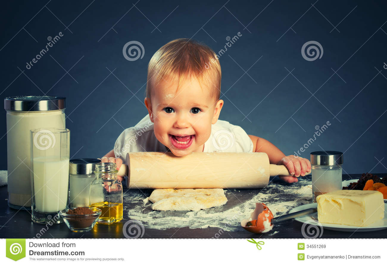 little baby girl is cooking  baking royalty free stock images